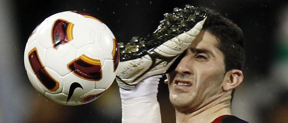 Jordan's Bashar Bani Yaseen kicks Syria's Malki in the face during their 2011 Asian Cup soccer match in Doha