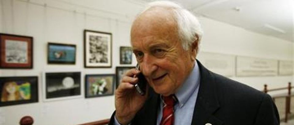 The chairman of the House Ways and Means Committee U.S. Rep. Sandy Levin speaks on a mobile phone after getting the Currency Reform for Fair Trade Act (HR 2378) passed on Capitol Hill in Washingto