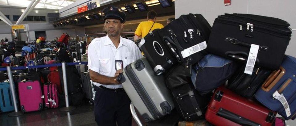 Airport baggage handler (Reuters)