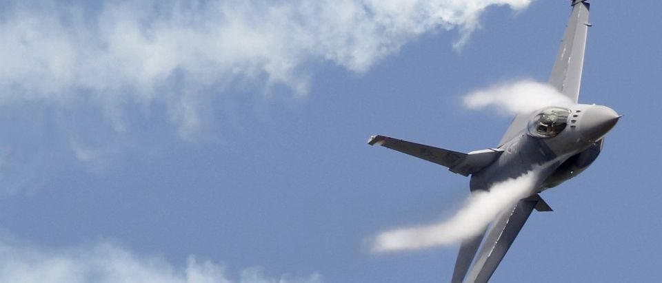 A F16 fighter jet takes part in a flying display during the 49th Paris Air Show at the Le Bourget airport