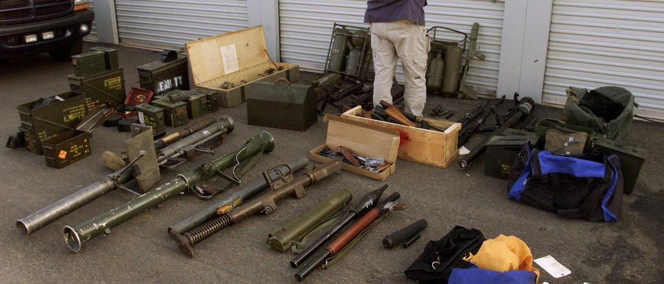 Anthony May, an explosives enforcement officer for the Bureau of Alcohol, Tobacco and Firearms from the Phoenix, Arizona bureau looks over a cache of firearms that was discovered at the Power Mini Storage in Queen Creek, Arizona, January 16, 2003. REUTERS/Jeff Topping