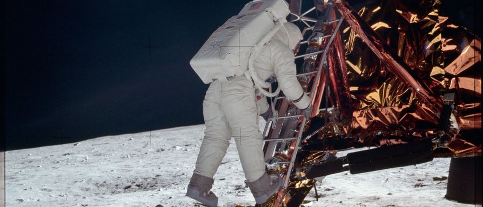 Astronaut Edwin E. Aldrin Jr., lunar module pilot, descends the steps of the Lunar Module (LM) ladder as he prepares to walk on the moon during the Apollo 11 mission in this NASA handout photo
