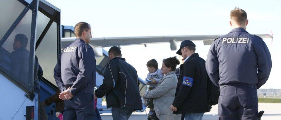Migrants board flight before deportation from Munich