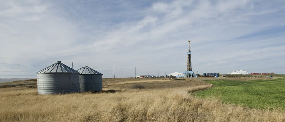 A drill rig abuts farmland on the Fort Berthold Reservation in North Dakota