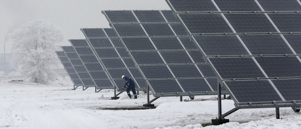 Duty engineer inspects equipment at Abakan solar electric station in suburb of Abakan