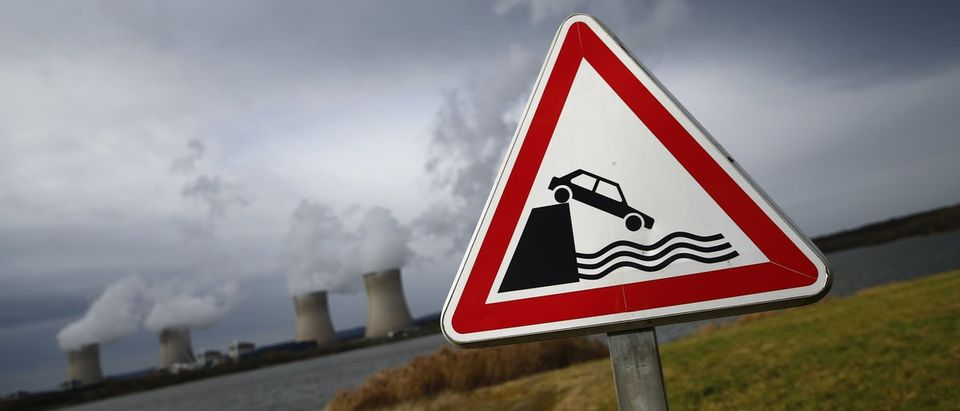 An open water proximity road sign warns car drivers of Lake Mirgenbach near the four cooling towers of the nuclear power plant of French supplier Electricite de France (EDF) in Cattenom
