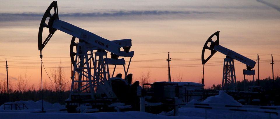 Pump jacks are seen at Lukoil company owned Imilorskoye oil field outside West Siberian city of Kogalym