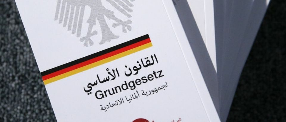 Copies of the German constitution translated into Arabic are pictured at German Federal Agency for Civic Education in Berlin