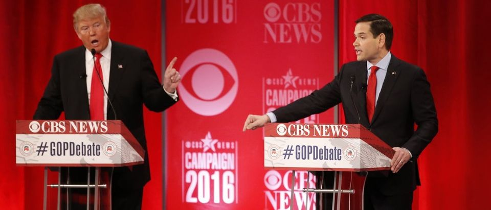 Republican U.S. presidential candidate Trump and Rubio speak at the same time as they discuss an issue at the Republican U.S. presidential candidates debate sponsored by CBS News and the Republican National Committee in Greenville