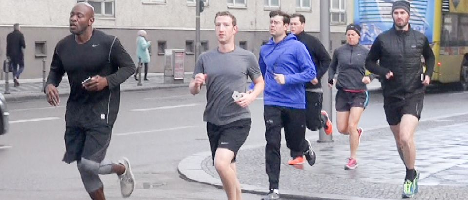 Mark Zuckerberg has several security guards join him for a run around Berlin