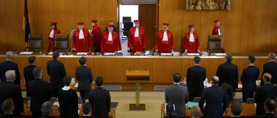 Andreas Vosskuhle (C) President of Germany's Constitutional Court leads his fellow judges into the courtroom for the start of the trial against the Nationaldemokratische Partei Deutschlands (NPD) in Karlsruhe, Germany, March 1, 2016. REUTERS/Kai Pfaffenbach