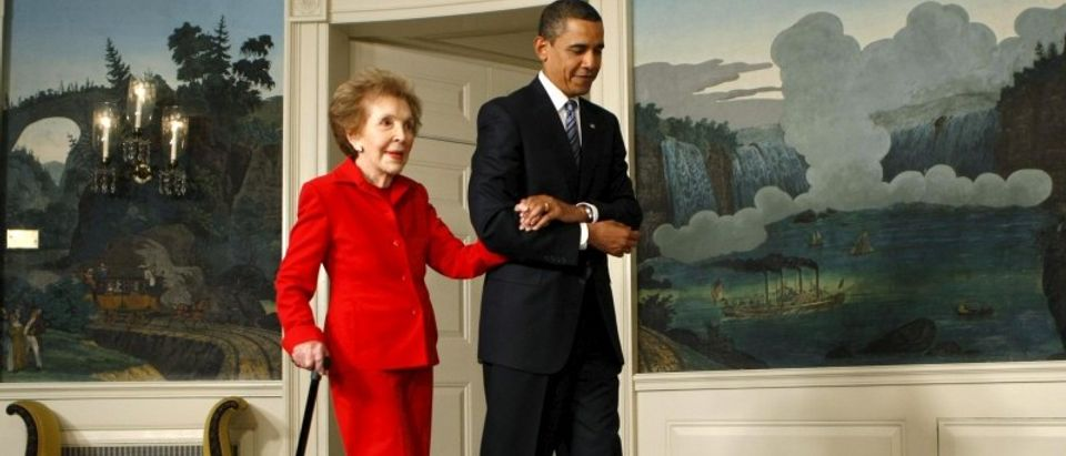 U.S. President Barack Obama escorts former first lady Nancy Reagan to a signing ceremony for the Ronald Reagan Centennial Commission Act in the Diplomatic Reception Room of the White House in Washington in this June 2, 2009 file photo. REUTERS/Kevin Lamarque/Files