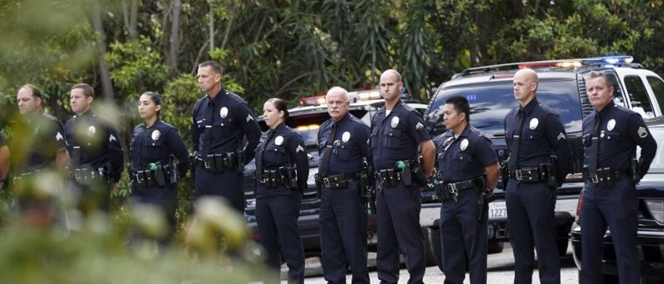 LAPD officers stand in line outside the estate of former U.S. first lady Nancy Reagan, who died at the age of 94, in the Bel-Air neighborhood of Los Angeles