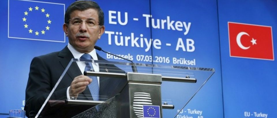 Turkish Prime Minister Ahmet Davutoglu speaks at a news conference at the end of a EU-Turkey summit in Brussels
