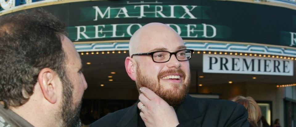 """File photo of Andy Wachowski of the new film """"The Matrix Reloaded"""" talks with the film's producer Joel Silver at the film's premiere in Los Angeles California"""