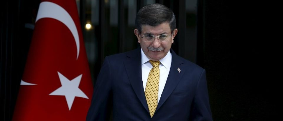 Turkish Prime Minister Ahmet Davutoglu leaves his office to welcome his Greek counterpart Alexis Tsipras in the Aegean port city of Izmir