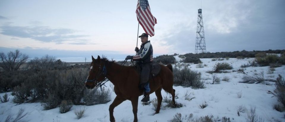 Occupier Duane Ehmer rides his horse Hellboy at Malheur National Wildlife Refuge near Burns, Oregon