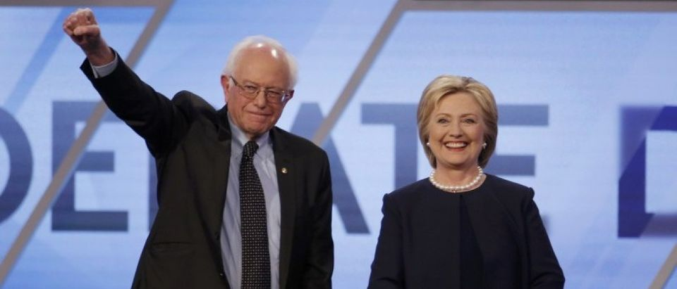 Democratic U.S. presidential candidates Senator Bernie Sanders and Hillary Clinton pose before the start of the Univision News and Washington Post Democratic U.S. presidential candidates debate in Kendall, Florida March 9, 2016. (REUTERS/Carlo Allegri)