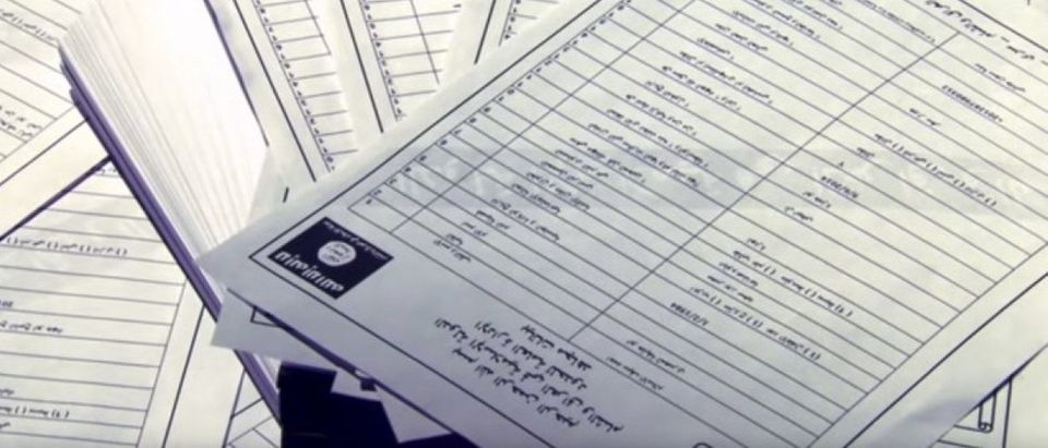 A still image from video shows documents identifying supporters of Islamic State