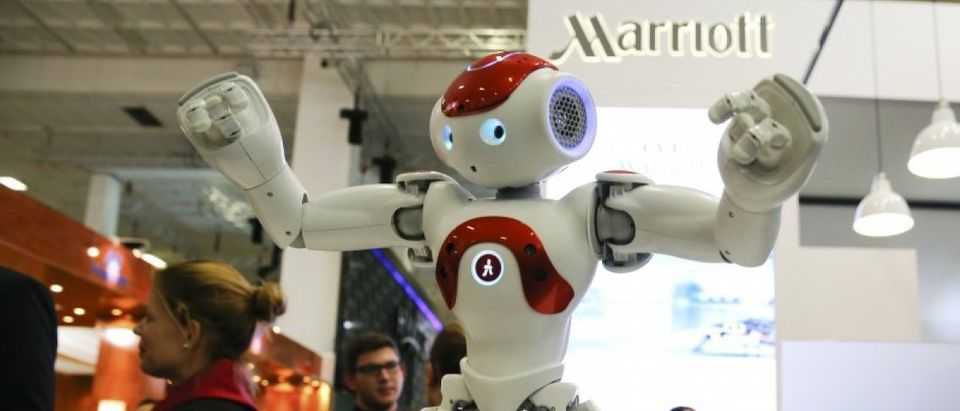 A Zora Bots humanoid robot called 'Mario' dances at the Marriott exhibition stand on the International Tourism Trade Fair in Berlin
