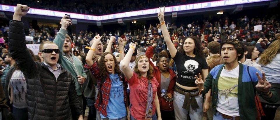 Demonstrators celebrate after Republican U.S. presidential candidate Donald Trump cancelled his rally at the University of Illinois at Chicago