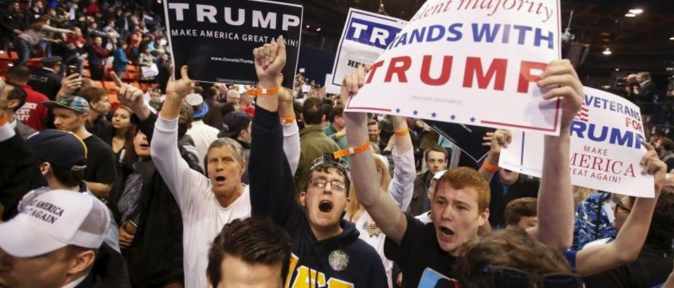Trump supporters hold signs after Republican U.S. presidential candidate Donald Trump cancelled his rally at the University of Illinois at Chicago