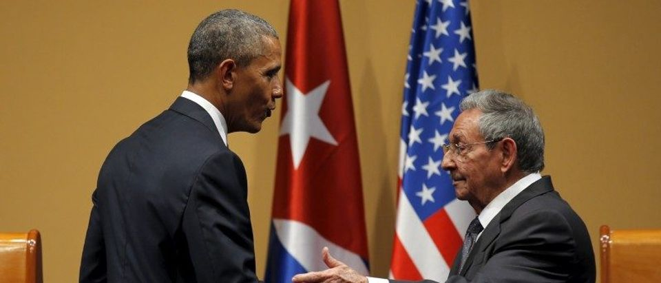 U.S. President Barack Obama shakes hands with Cuban President Raul Castro after a news conference as part of Obama's three-day visit to Cuba, in Havana