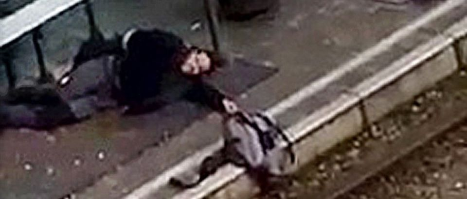 Terror suspect Abderahmane Ameroud lies on the platform of a tramway station, in this image taken from amateur video, after he was shot and wounded by police in the Brussels borough of Schaerbeek, following Tuesday's bombings in Brussels,