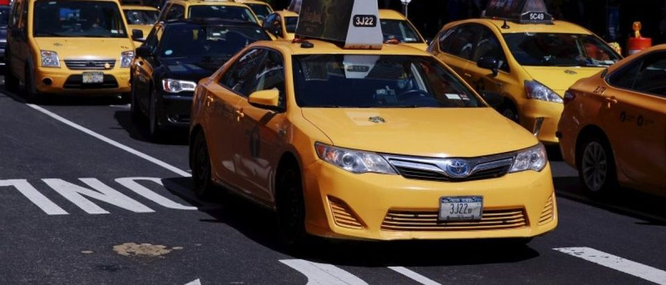 A New York City taxi cab drives through Times Square in New York