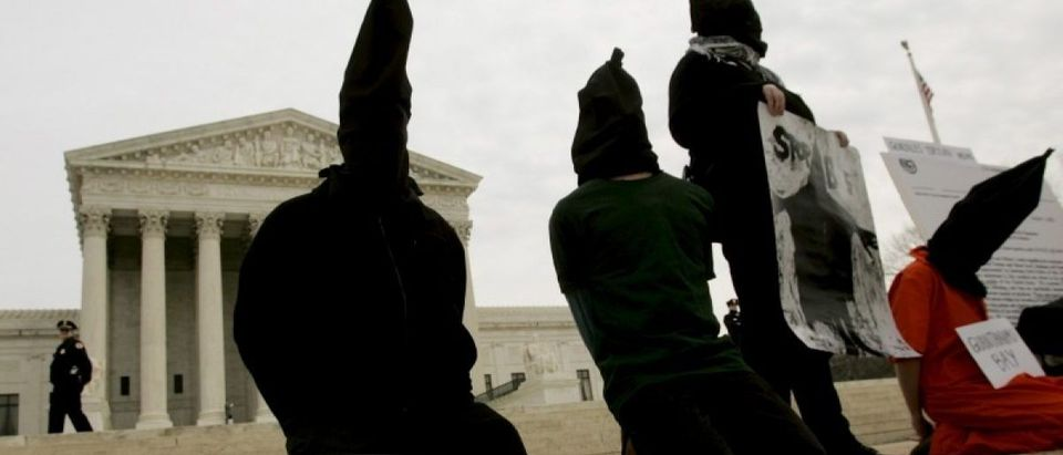 """File photo of District of Columbia Anti-War Network activists taking part in a demonstration to oppose """"American violations of international human rights"""" at the Abu Ghraib prison in Iraq by U.S. military personnel in front of the U.S. Supreme Court"""