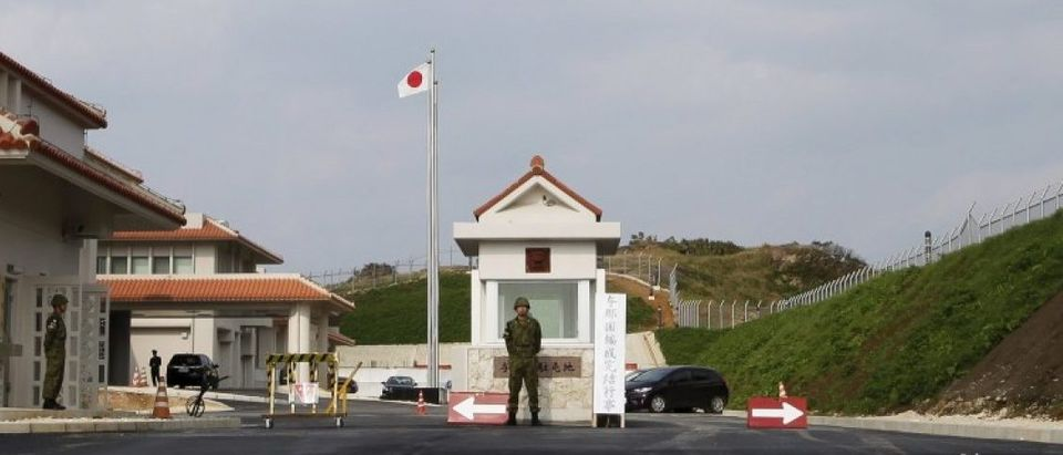 A Japan's Self Defence Force soldier keeps watch at the entrance of the newly opened military base on the island of Yonaguni in the Okinawa prefecture
