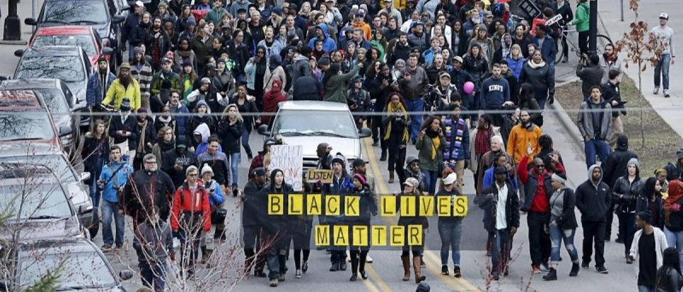Protesters march during a rally after prosecutors announced that two police officers involved in the shooting death of 24-year-old black man Jamar Clark will not be charged, in Minneapolis, Minnesota March 30, 2016. REUTERS/Adam Bettcher