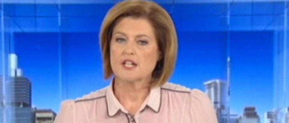 News anchor's shirt looks like boobs.