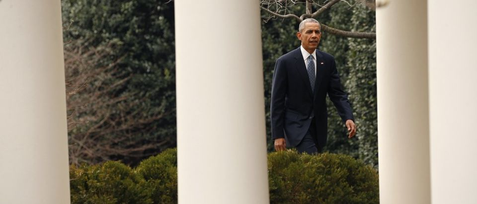 U.S. President Obama walks back to the Oval Office after participating in a joint press conference with Canadian Prime Minister Trudeau in the Rose Garden at the White House in Washington