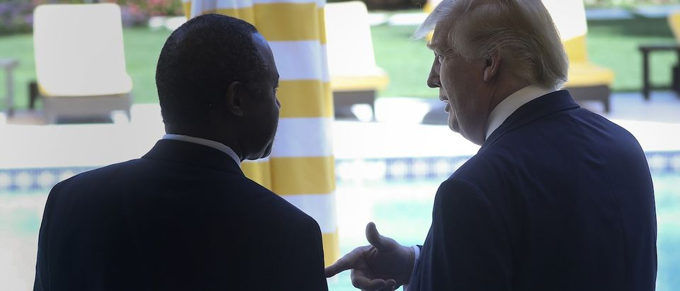 Republican presidential candidate Donald Trump speaks with Ben Carson after receiving Carson's endorsement at a campaign event in Palm Beach, Fla., March 11, 2016