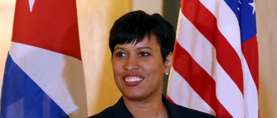 Washington Mayor Muriel Bowser stands between Cuban and U.S. national flags during a news conference in Havana