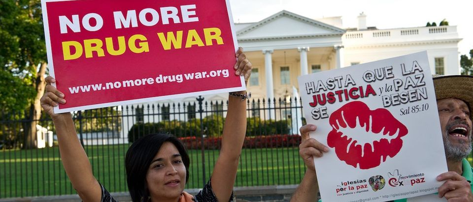 "Protestors chant slogans in front of the White House in Washington on September 10, 2012 during the ""Caravan for Peace,"" across the United States, a month-long campaign to protest the brutal drug war in Mexico and the US. The caravan departed from Tijuana in August with about 250 participants and ended in Washington. AFP PHOTO/Nicholas KAMM (Photo credit should read NICHOLAS KAMM/AFP/GettyImages)"