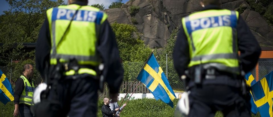 Protesters hold Swedish flags as they demonstrate against a new mosque at Keillers Park in Gothenburg, southwest Sweden, on May 21, 2011. Around 100 people, many waving Swedish flags and wearing T-shirts with a red line drawn through a picture of the mosque, joined the right-wing demonstration against the building, which is set to be inaugurated next month, police said. (Jonathan Nackstrand/AFP/Getty Images)