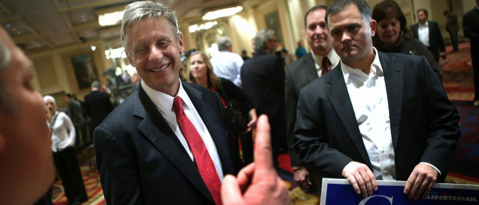 Libertarian Party candidate Gary Johnson greets supporters prior to a debate hosted by the Free and Equal Elections Foundation and moderated by former CNN talk-show host Larry King