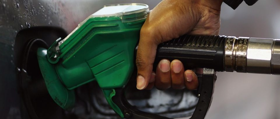 A driver fills their car with petrol at a filling station on December 17, 2014 in London, England. The motoring organisation the RAC has predicted that fuel prices at the pumps could soon sell for below £1 GBP a litre, the lowest level since May 2009, due to the plummeting price of oil. (Dan Kitwood/Getty Images)