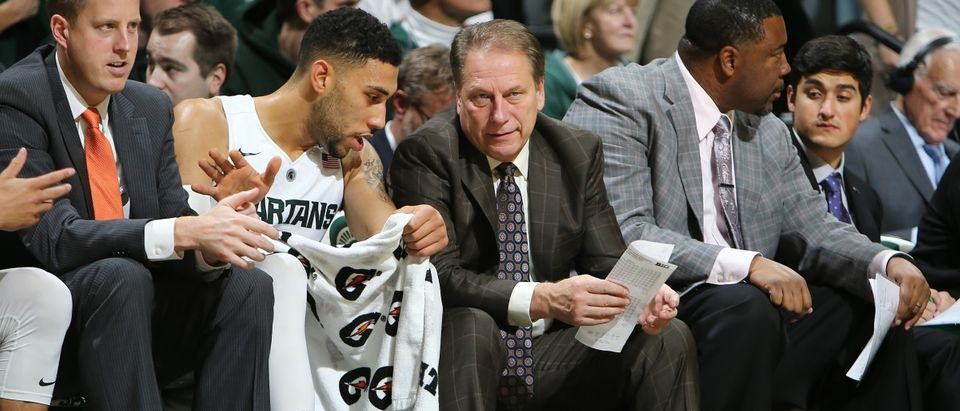 Head coach Tom Izzo of the Michigan State Spartans talks to Denzel Valentine of the Michigan State Spartans during the game against the Arkansas-Pine Bluff Golden Lions at the Breslin Center on Nov. 20, 2015 in East Lansing, Mich