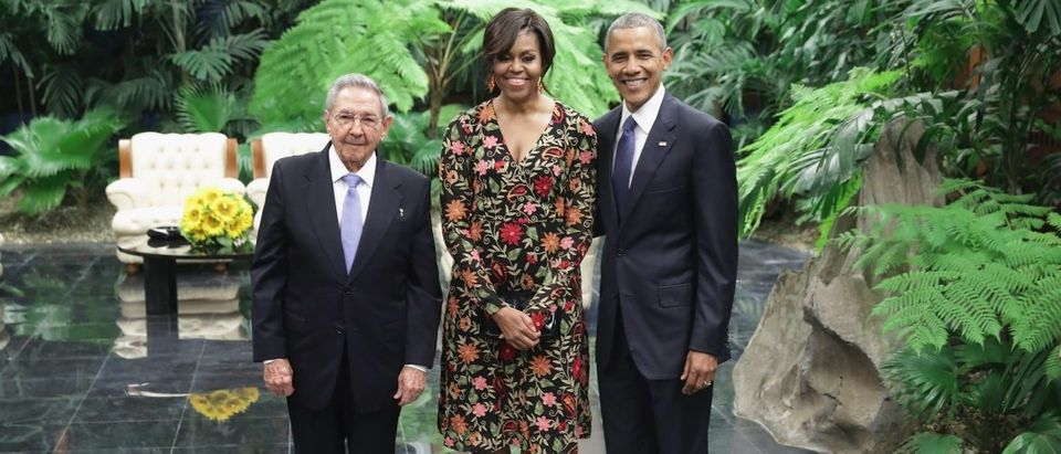 Cuban President Raul Castro (L) poses for a photograph with U.S. first lady Michelle Obama and U.S. President Barack Obama before a state dinner at the Palace of the Revolution March 21, 2016 in Havana, Cuba. (Chip Somodevilla/Getty Images)