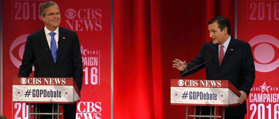 Former Governor Jeb Bush listens as Senator Ted Cruz speaks at the Republican presidential candidates debate sponsored by CBS News and the Republican National Committee in Greenville, South Carolina