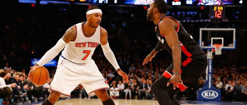 Carmelo Anthony of the New York Knicks dribbles against Patrick Patterson of the Toronto Raptors during their game at Madison Square Garden