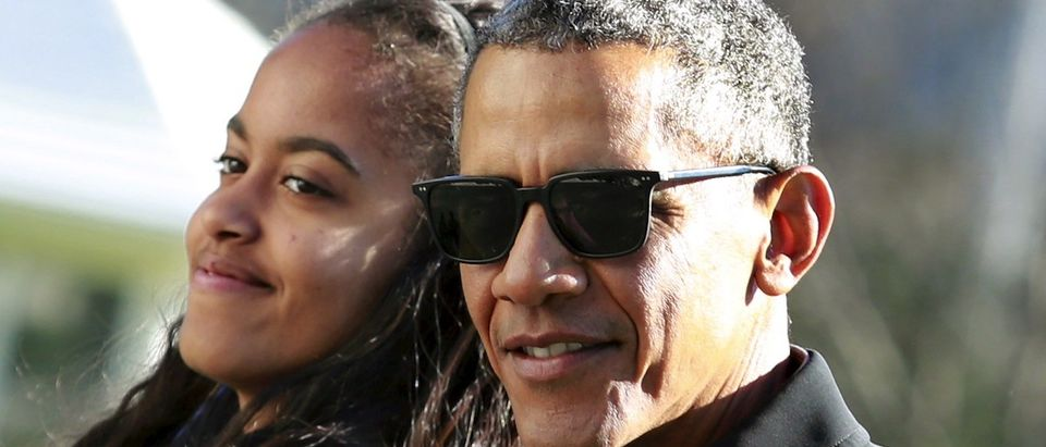 President Barack Obama walks with his daughter Malia on the South Lawn of the White House
