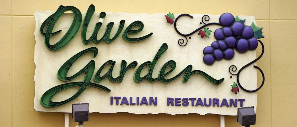 The sign outside the Olive Garden restaurant is seen in Westminster, Colorado March 19, 2015. (REUTERS/Rick Wilking)