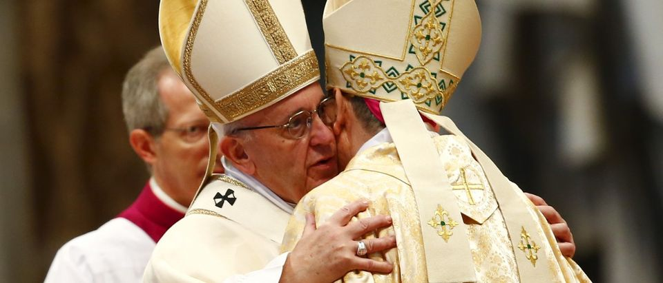 Pope Francis embraces newly ordained bishop Ayuso Guixot from Spain during an ordination ceremony in Saint Peter's Basilica at the Vatican