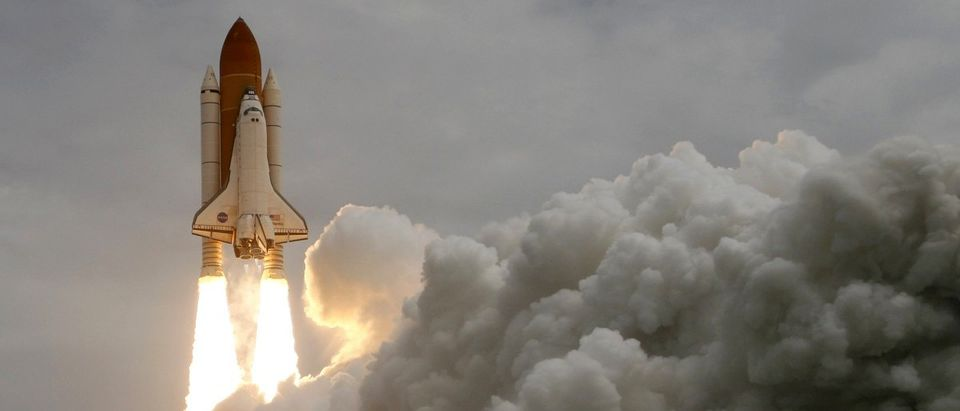 The space shuttle Atlantis STS-135 lifts off from the launch pad.