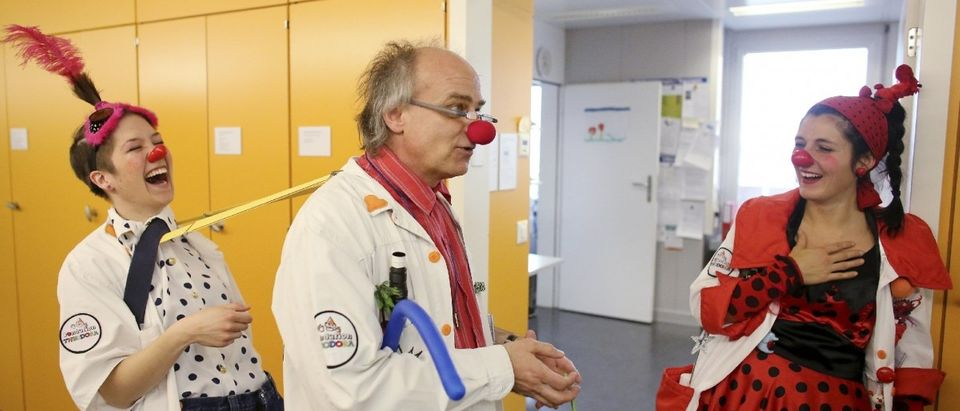 Clown doctors of the Theodora foundation joke during a break at the Insel university's hospital for children in Bern