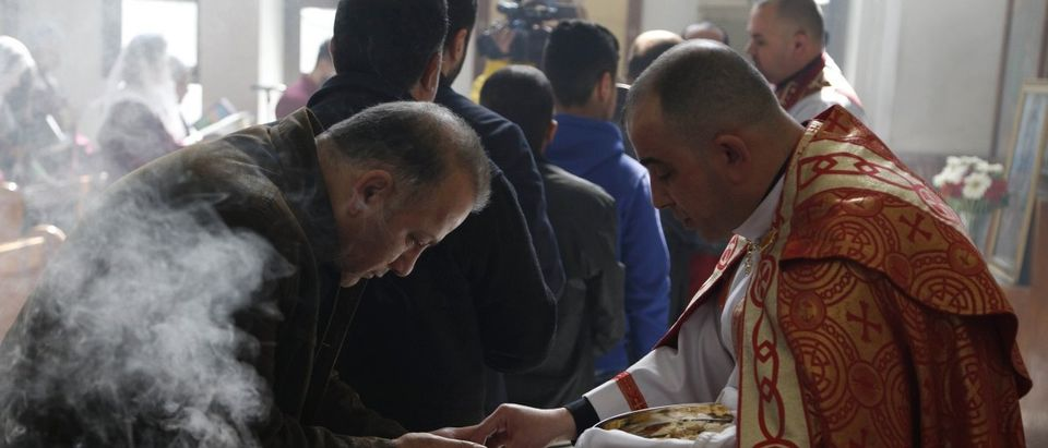 Assyrians attend a mass in solidarity with the Assyrians abducted by Islamic State fighters in Syria earlier this week, inside Ibrahim al-Khalil church in Jaramana, eastern Damascus